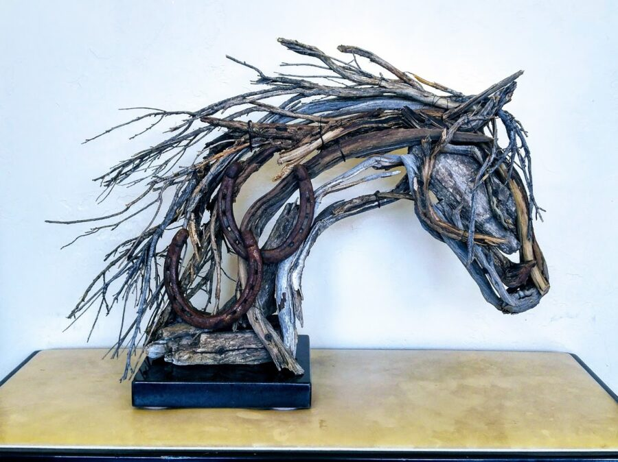 Photo of mixed media horse head sculpture with horse shoe by Brenna Kimbro