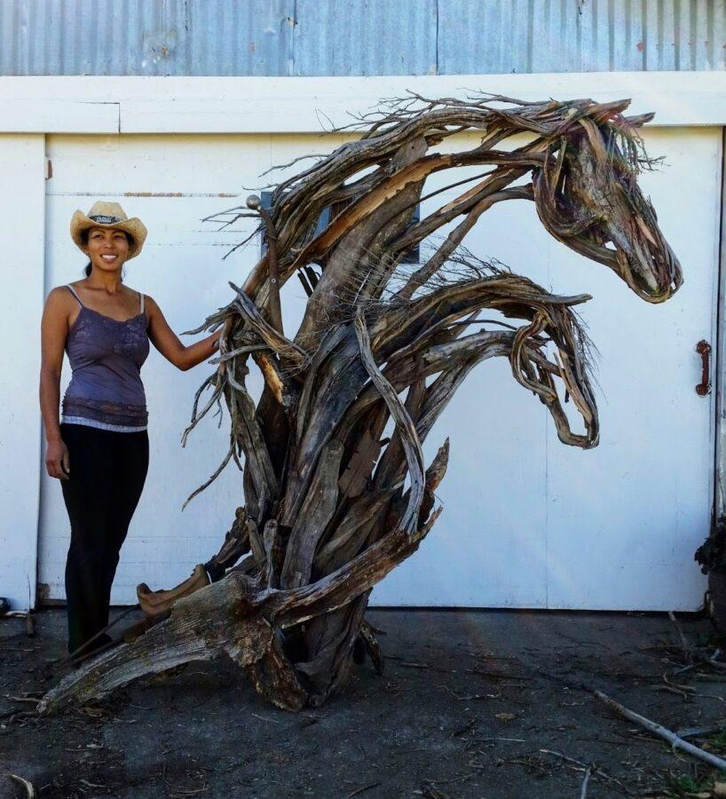 Photo of mixed media horses head sculpture with artist Brenna Kimbro