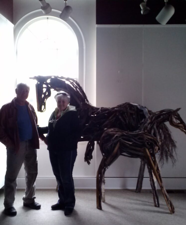 Photo of two mixed media horse sculptures by Brenna Kimbro