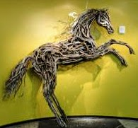 Photo of mixed media horse on hinde legs sculpture by Brenna Kimbro