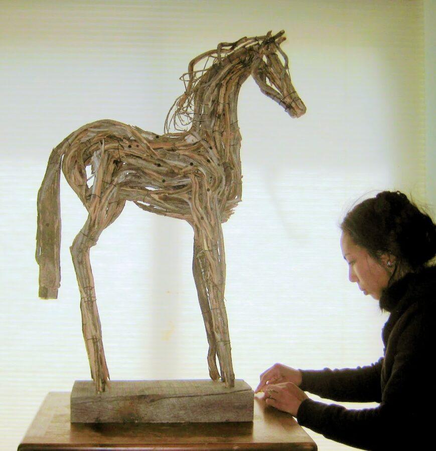 Photo of mixed media horse sculpture wtih artist Brenna Kimbro