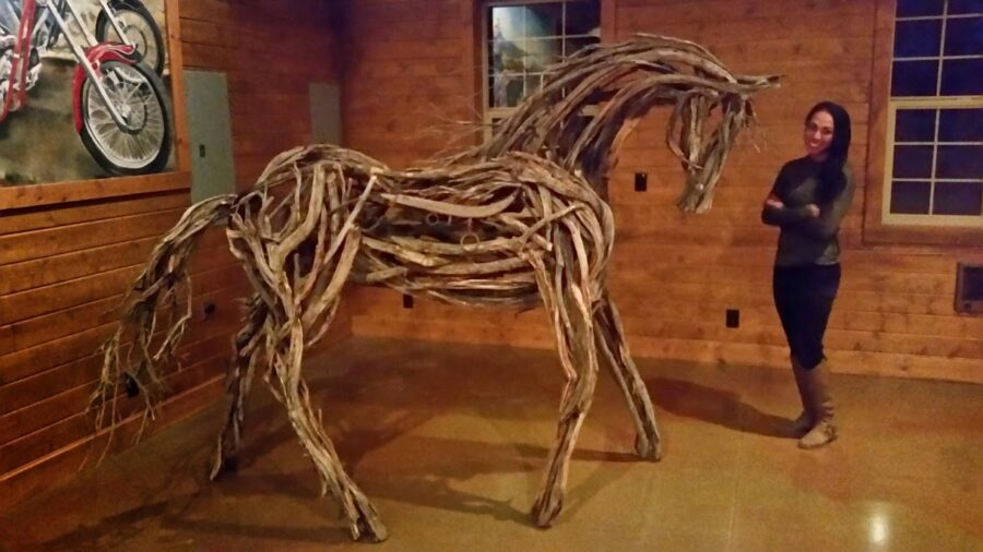 Photo of mixed media horse sculpture with artist Brenna Kimbro
