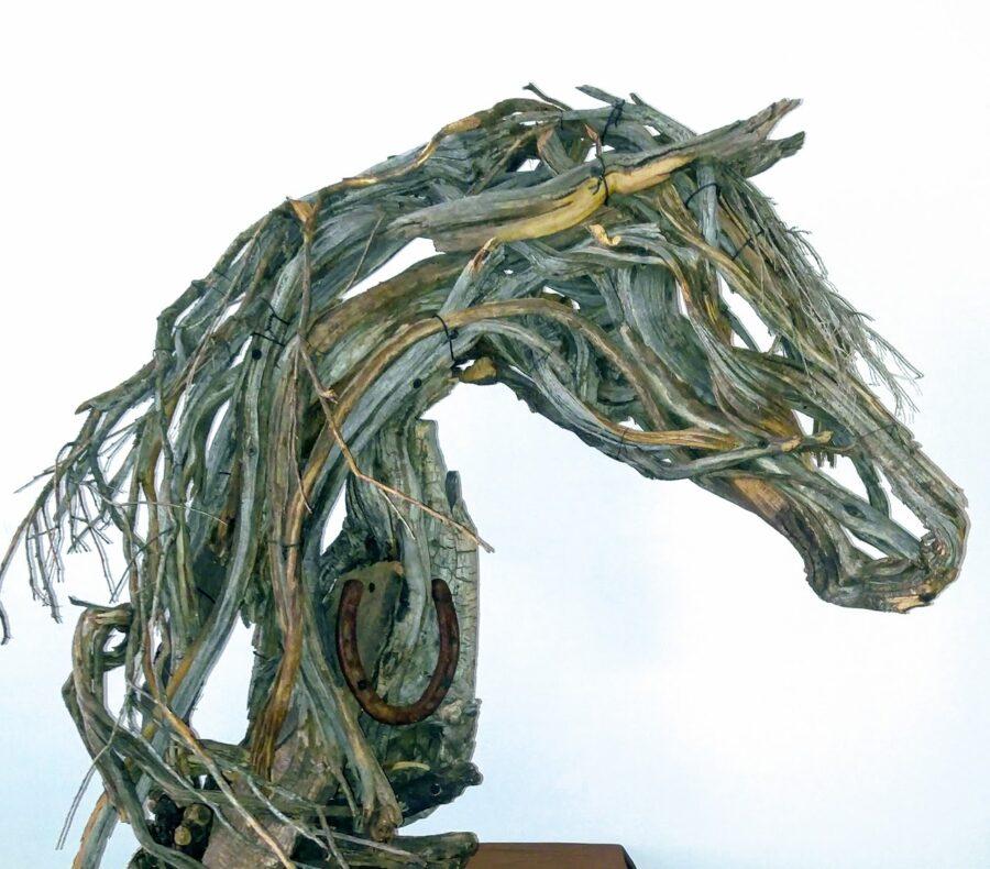 Photo of mixed media horse head with horse shoe by Brenna Kimbro